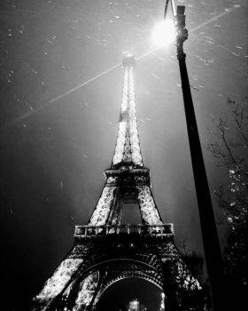 Dramatic Eiffel Tower at night by simonknittel