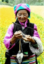 Spinning Wool, Tibet by BeccaJef