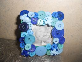 All blue button frame by Pixie-Aztechia