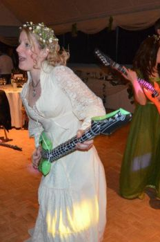 Happy Bride With Her Illuminous Inflatable Guitar! by DragonTreasureArt