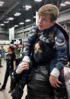 Winter Soldier Giving Tiny Captain America a Ride by LaneDevlin