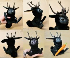 eBay auction - black jackalope by Magweno