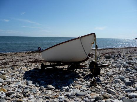 lyme bay with boat by alitaz