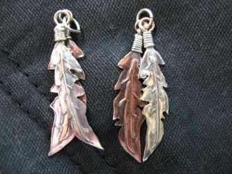 feather earrings by psychopunk5000