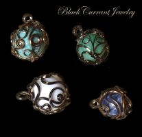 Wrapped Planets by blackcurrantjewelry