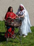 Two women of ancient Rome light up the sacred fire by Book-Art