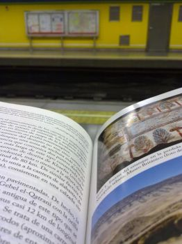 Reading in the subway by Airha