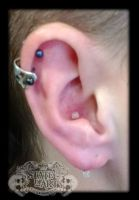Vertical lobe by state-of-art-tattoo