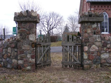 Stone Fence Wooden Gate by OsorrisStock