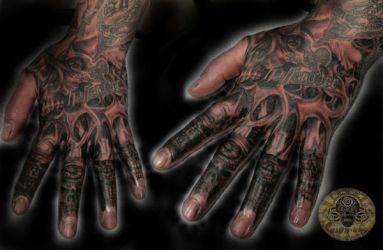 Skulls demon hand tattoo by 2Face-Tattoo