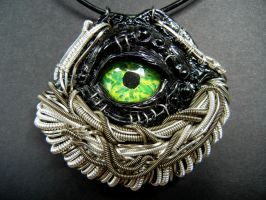 Evil eye wire wrapped polymer clay pendant by dogzillalives