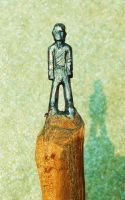 A Pencil Graphite Carved Man by Geotjakra