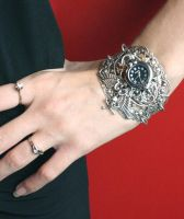 Silver skull watches by Pinkabsinthe