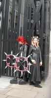 Axel and Larxene at the gates by KellyJane