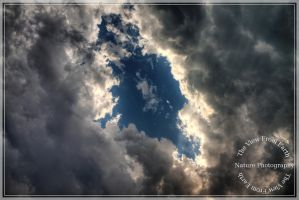 Blue hole in the clouds by Ankh-Infinitus