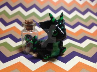 Black and Green Baby Dragon by xlightangelwolfx