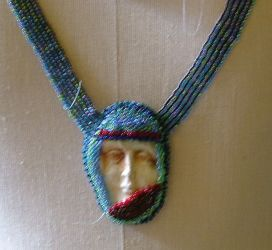 Blue face necklace by nellielaan