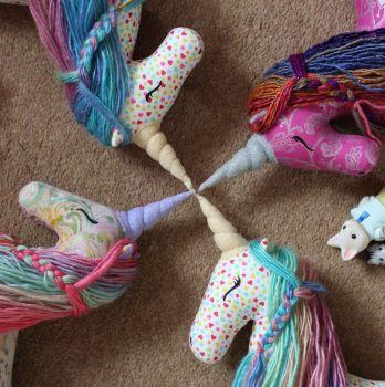 A herd of unicorns ready for shipping! by StitchItMama
