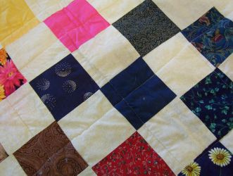 Quilt with pink blue brown and green patches by caspercrafts