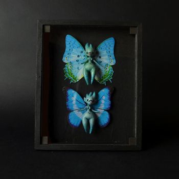 Glow in the Dark Pixies in a Wooden Case by falauke