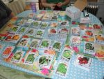 Seed packets spread out on a table by caspercrafts