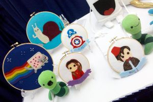 SDCC 2011 Art Show table 3 by brokensymphony