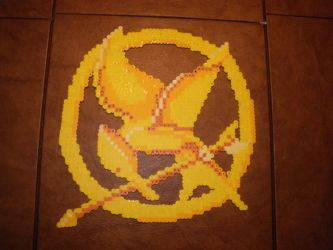 Mockingjay Pin by toxicbeagle