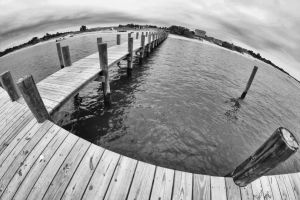 Black and white pier by denehy
