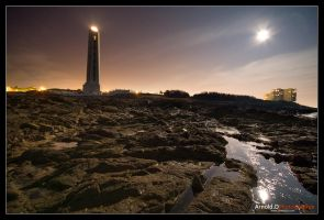 Lighthouse in the moonlight by Arnold-d