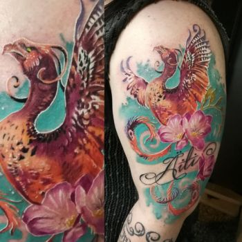 Colorful Phoenix tattoo by tuomaskoivurinne