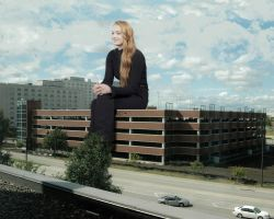 Sophie Turner sitting on a parking structure by Natkatsz