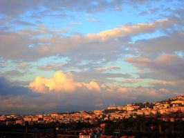 Clouds above the city by buraaka