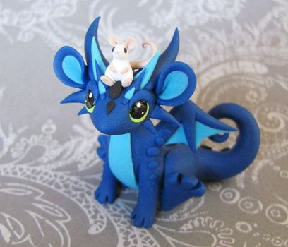 Blue dragon with mouse pal by DragonsAndBeasties