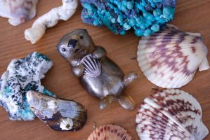 Shimmering Sea Otter Figurine with a Clam by MiniMynagerie