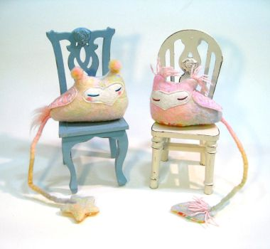 Cowls on chairs by Lithe-Fider
