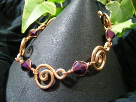 Copper Spirals With Purple BiCone Bracelet by BacktoEarthCreations