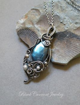 Faceted Teardrop Labradorite with dark silver by blackcurrantjewelry
