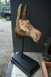 Chain saw donkey sculpture out of timber cut off by animel