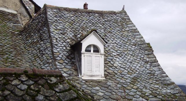 WHITE WINDOW IN SLATE ROOF AND CLOUDS by isabelle13280