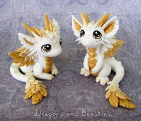 Baby Angel Dragons by DragonsAndBeasties