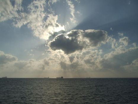 Light between Clouds on Sea by cfs3creative