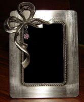 Pewter Bow Picture Frame 2 by FantasyStock