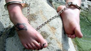 Shackled feet at the river by VampZIM