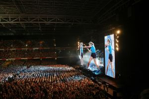 Giant Taylor Swift in concert throwing little  by joe116able