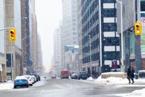 Snowy day downtown by Spid4