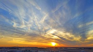 PHL Sunrise Contrails by FauxHead