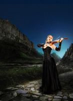 Blonde Lady Playing The Violin In The Evening by Stanley-ontheroad