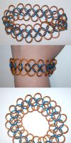 Big Ring OrangeNBlue bracelet by BardicKitty