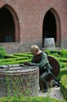 Robin Hood praying at the well by Dewfooter