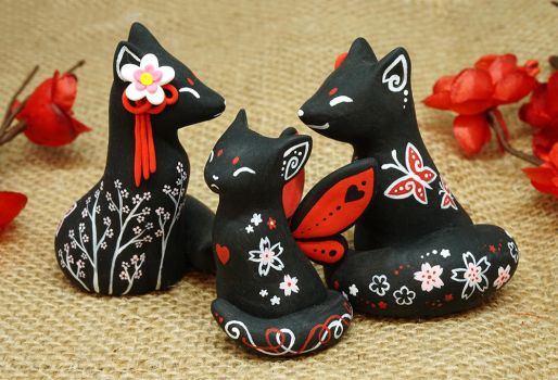 Black Oriental Foxes and a Cat by Ailinn-Lein